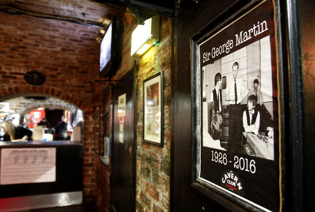 Tributes to the record producer known as the Fifth Beatle, Sir George Martin, are placed at The Cavern, Liverpool following his death aged 90. Sir George helped The Beatles achieve global success while head of the Parlophone record label after hearing their demo tape in 1962. His family confirmed he died peacefully at his home as tributes poured in from the world of music and beyond.