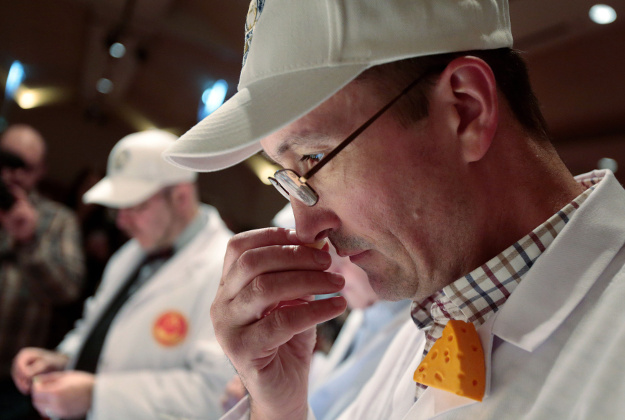 Adrian Fowler, a cheese judge from the United Kingdom associated with the Society of Dairy Technology and the British Specialist Cheesemakers Association, smells a sample of Roth Grand Cru Surchoix by Emmi Roth USA during the final round of judging at the 2016 World Championship Cheese Contest at Monona Terrace Community and Convention Center in Madison, Wis., Wednesday, March 9, 2016. The cheese, later named world champion, was made in Monroe, Wis., and is the first American-made cheese to win the top prize since 1988.