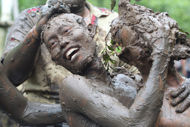 Balinese men covered with mud to purify themselves from evil spirits during a Hindu ritual called ''Mabuug-buugan'' at Kedonganan village in Bali, Indonesia.