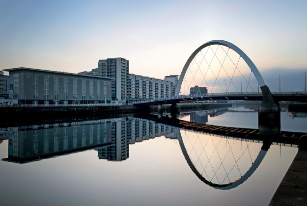 A landmark of Glasgow, the Clyde Arc Bridge, is reflected in the unusually still waters of the River Clyde, Glasgow.