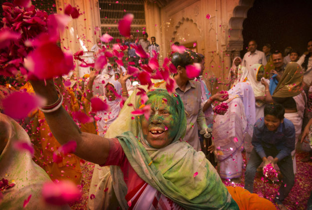 Indian Hindu widows throw flower petals and colored powder during Holi celebrations at the Gopinath temple, 180 kilometres (112 miles) south-east of New Delhi, India Monday, March 21, 2016. A few years ago this joyful celebration was forbidden for Hindu widows. Like hundreds of thousands of observant Hindu women they would have been expected to live out their days in quiet worship, dressed only in white, their very presence being considered inauspicious for all religious festivities.