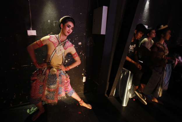 A Thai student actor warms up before a performance of Thai traditional Khon theater in Bangkok on Tuesday, March 22, 2016. Students at the Bunditpatanasilpa Institute are trained in traditional forms of drama, music and other arts in order to promote Thai culture.