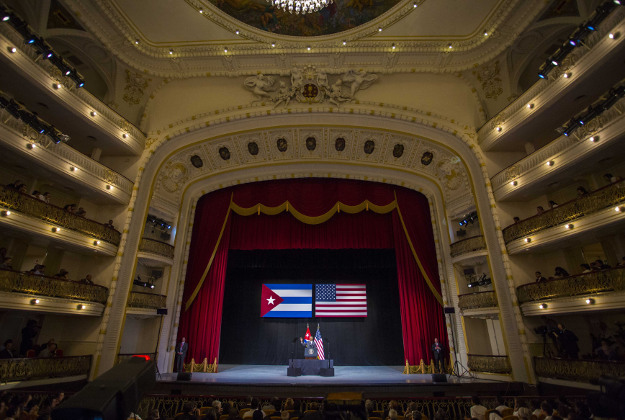 """U.S. President Barack Obama waves to the crowd before he delivers his speech at the Grand Theater of Havana, Tuesday, March 22, 2016. Obama who is in Cuba in a trailblazing trip said he came to Cuba to """"bury the last remnant of the Cold War in the Americas."""""""