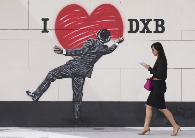 A woman walking past a piece by British stencil artist Nick Walker, at the launch of Dubai Walls at City Walk, Dubai - the first large-scale collection of street art in the Middle East, featuring 14 of the world's top street artists representing five continents.
