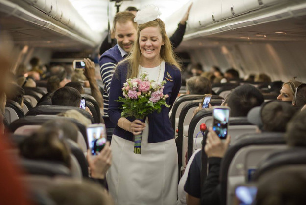 Kirsty and Jim exchanged vows on a packed plane.