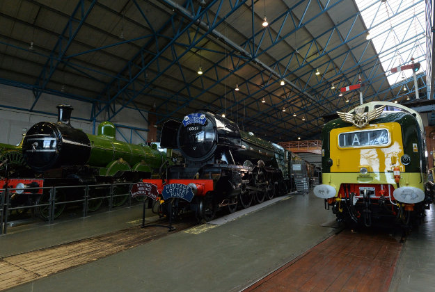 he Flying Scotsman (centre) between the Henry Oakley (left) and Kings Own Yorkshire Light Infantry locomotives during the Scotsman Season Displays at the National Railway Museum, York.
