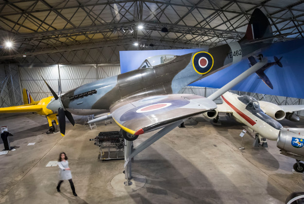 National Museums Scotland employee Alice Wyllie poses in front of a Spitfire at the National Museum of Flight in East Lothian, ahead of the 80th anniversary of the first Spitfire flight which took place on March 5, 1936. Image by: Danny Lawson/PA Wire.
