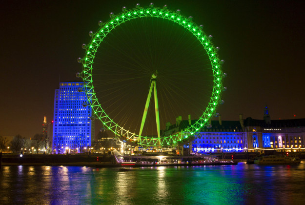 The Coca-Cola London Eye, on London's South Bank is lit green by Tourism Ireland to celebrate St Patrick's Day.