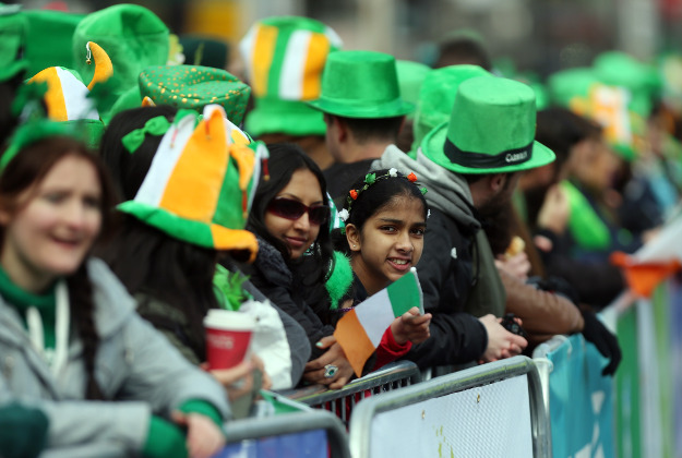 The crowd waits for the start of the St Patrick's Day parade on the streets of Dublin.