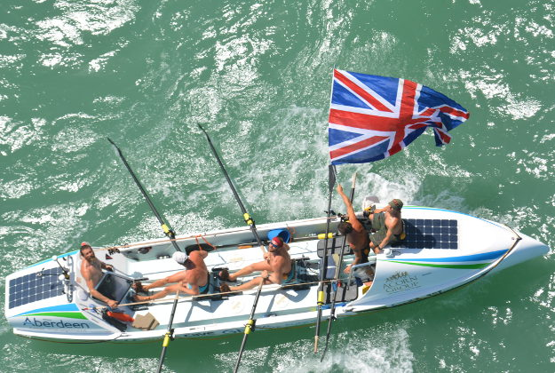 Nick Hipkin handout photo taken from a Trinidad and Tobago Air Guard helicopter escorting five British rowers who have entered the record books after becoming the fastest crew to row the longest route across the Atlantic Ocean