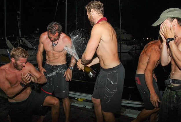 Oliver Bailey, Jason Fox, Mathew Bennett, Ross Johnson celebrating after they arrived in Trinidad. The British men have broken two world records and become the fastest crew to row the longest route across the Atlantic Ocean - despite capsizing three times.