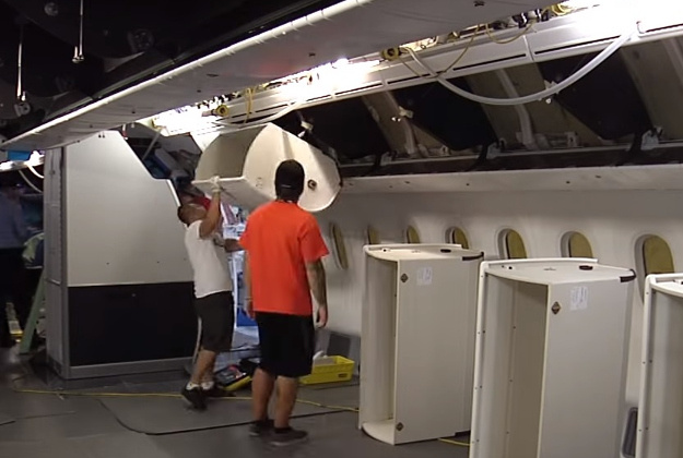 Workers inside the shell of the jet plane
