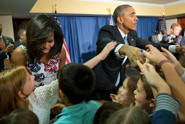 Michelle and Barack greet the children of the newly opened US embassy employees