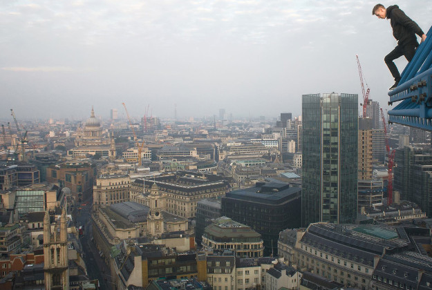 Undated handout photo issued by Matthew Adams of the urban explorer at the top of the Lloyds building in London.