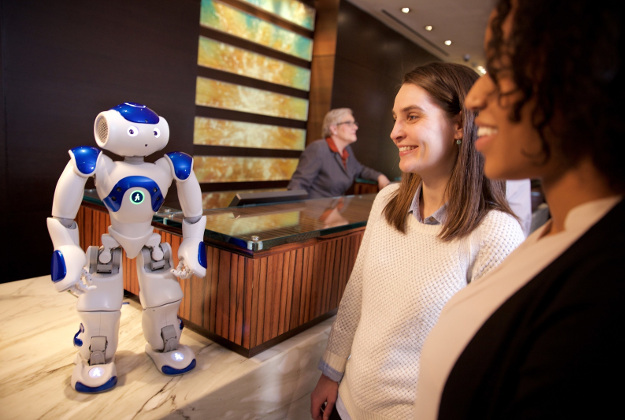 "Visitors to the Hilton Hotel in McLean, Va. meet ""Connie,"" a robot concierge named after Conrad Hilton and powered by IBM Watson and WayBlazer. Connie, in pilot testing at the hotel, uses cognitive computing and machine learning to answer questions posed in natural language about the hotel, local tourist attractions and restaurants -- while learning with each interaction."