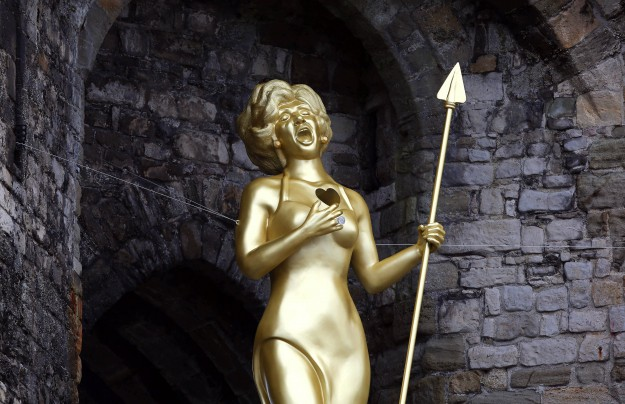 Welsh artist Marc Rees unveils his sculpture 'Bassey's Cry / Bloedd Bassey', a 20-foot tall likeness of Dame Shirley Bassey as Celtic Warrior Queen Boadicea at Caernarfon Castle in Wales, to launch the 'Get Creative' Weekend.