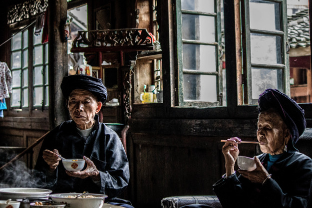 l was invited into the home of my guide and I stayed for lunch. This picture for me captures the comfortable relationship between the husband and wife and a thoughtful moment. Location: Longsheng, Guangxi Zhuangzu Zizhiqu, China