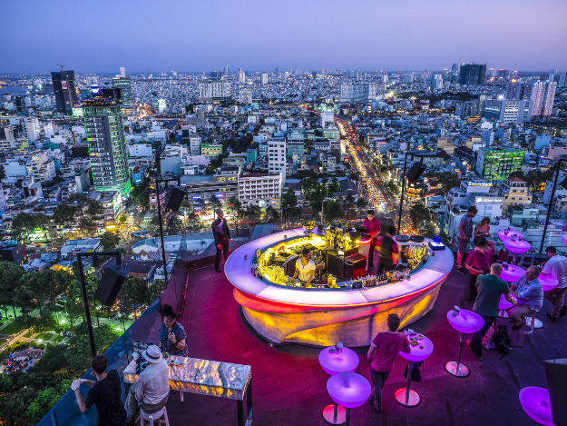 New York, Rio, Tokyo? We are on a rooftop bar in Ho-Chi-Minh, Vietnam. The day leaves, the night comes. But this coming city never sleeps. Location: Ho Chi Minh, Vietnam