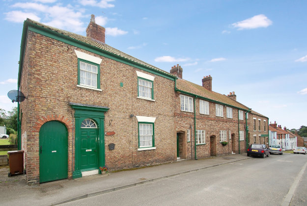 Properties in High Street, as part of a sale for the West Heslerton Estate, Malton, North Yorkshire with an estimate of £20 million.