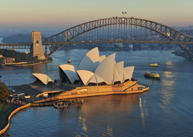 Overview of Opera House and Harbour Bridge at dusk.