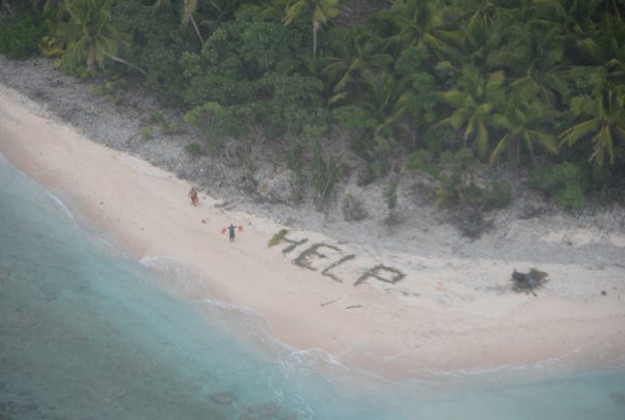 Photo posted to Twitter of the men's HELP sign spelt in palm leaves