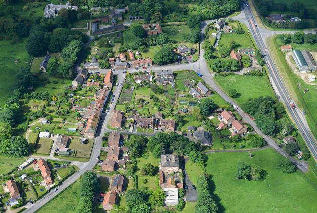 West Heslerton Hall (top left) and West Heslerton village as part of a sale for the West Heslerton Estate, Malton, North Yorkshire with an estimate of £20 million, including its 21-bedroom mansion, 43 houses, a pub, a range of other buildings and more than 2,000 acres of farmland.