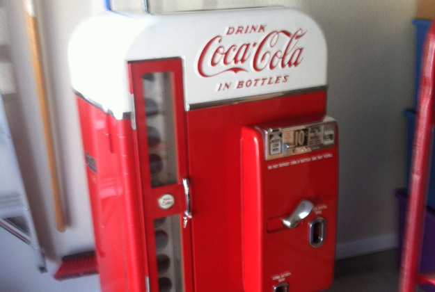 The same brand and year of the coke machine used in the original film