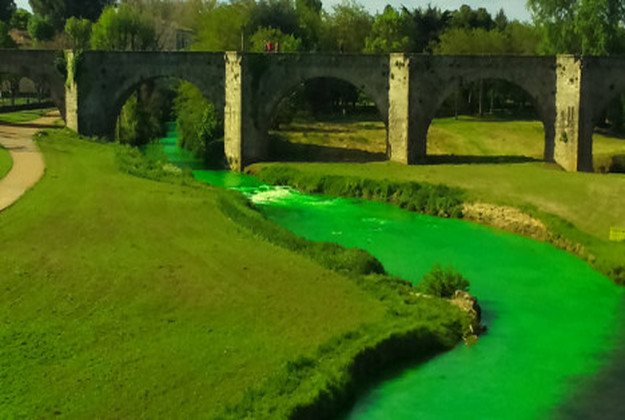 French rivers have been dyed green to highlight the lack of funding being allocated for environmental matters