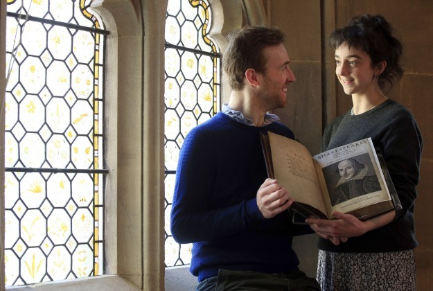 Actors John Heffernan and Patsy Ferran talk over the first folio of William Shakespeare's collected plays published on the 400th anniversary of his death