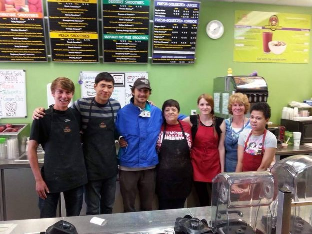 Shia posing with the staff at the Cheyenne smoothie shop Ruby Juice.