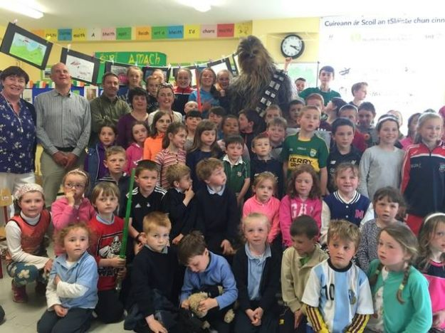 The 7 ft Wookie posed with the school children and teachers.
