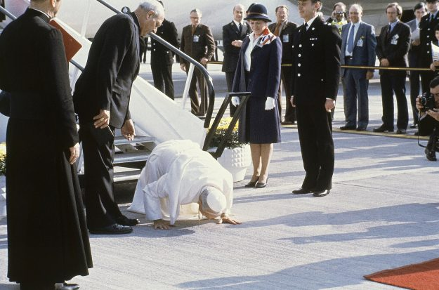 Pope John Paul II kisses the ground as he arrives at Gatwick Airport for a six day visit to Great Britain on May 28th, 1982.