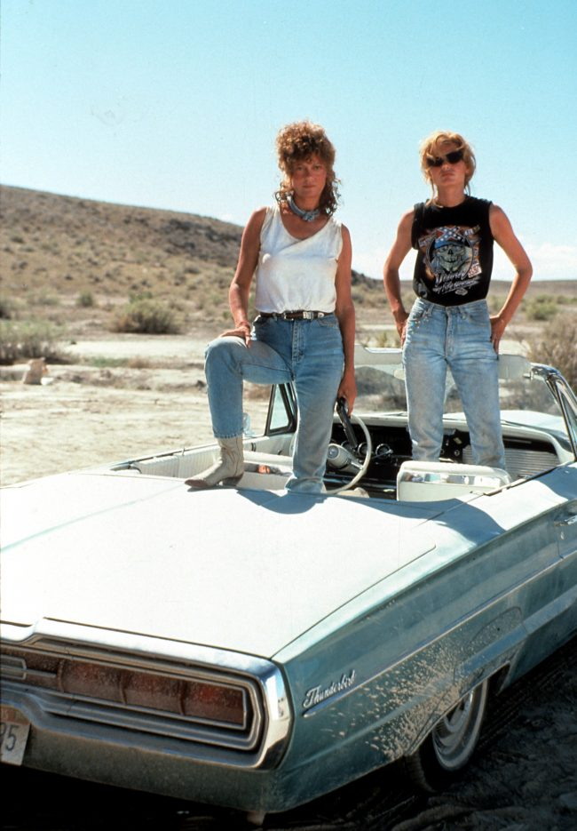 Susan Sarandon and Geena Davis standing in the convertible in publicity portrait for the film 'Thelma & Louise', 1991. (Photo by Metro-Goldwyn-Mayer/Getty Images)