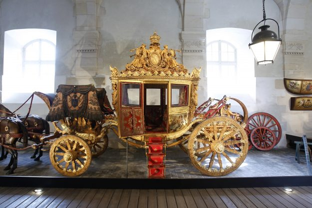"""Charles X's coronation coach is displayed in the King's Great Stables next to the """"Chateau de Versailles"""" on May 09, 2016 in Versailles, France. After 9 years of closure and a complete renovation, the gallery carriages reopens to the public on May 10, 2016. This collection of coach is one of the largest in Europe."""