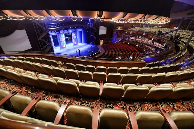 A picture taken on May 12, 2016 at the STX shipyard of Saint-Nazaire, western France shows the auditorium inside the Harmony of the Seas cruise ship during the delivery ceremony of the boat. With a capacity of 6.296 passengers and 2.384 crew members, the Harmony of the Seas, built by STX France for the Royal Caribbean International, is the world's largest ship cruise.