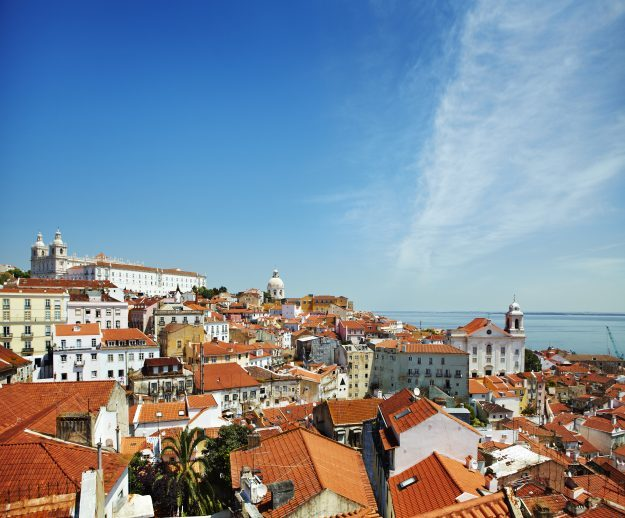 Overview of Alfama district beside Tagus River estuary.