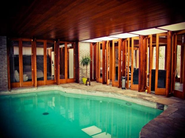The property features a pool and a wood lined interior.