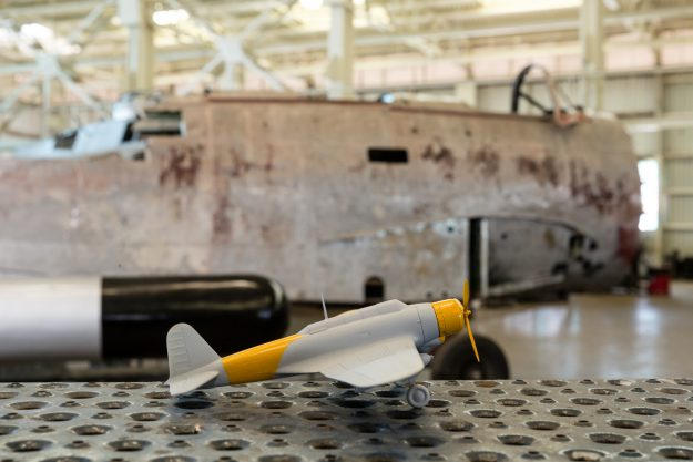 Scale model in front of the forward part of the Fuselage.