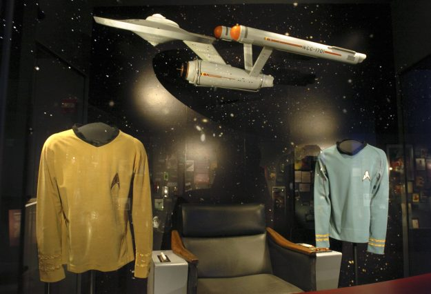 Shirts and a model from Star Trek are seen on display at The Science Fiction Museum