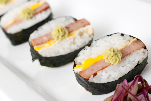 SPAM® Sushi Grilled SPAM®, sushi rice, fried egg and wasabi rolled in nori (dried seaweed).