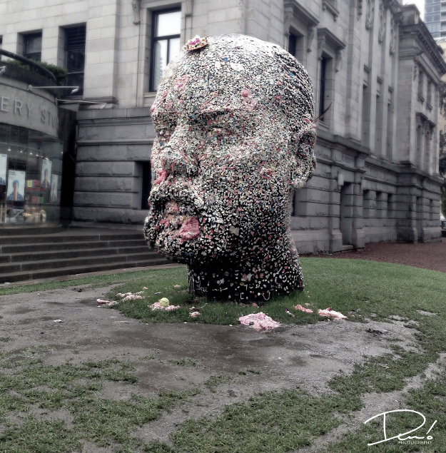 A sculpture of Douglas Coupland's head, covered with chewing gum, in Vancouver.