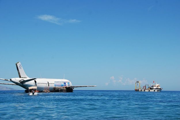 An Airbus A300 plane is seen on water as it will be sunk in the waters of the Aegean Sea