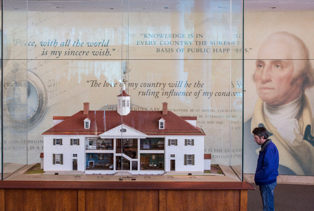 A visitor views a model of the estate inside the welcome center at George Washington's Mount Vernon Estate.