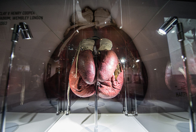 The Ali 'split glove' from the 1963 fight v Henry Cooper at Wembley, when Ali's (at the time known at Cassius Clay) glove split in the forth round - at the preview of the 'I Am The Greatest' Muhammad Ali exhibition at the O2 on March 3, 2016 in London, England. The exhibition showcases the life and career of heavyweight boxer Muhammad Ali and features over more than 100 artefacts including personal memorabilia, unseen footage and photographs. It is open to the public from Friday 4 March, 2016 at the O2 in London.