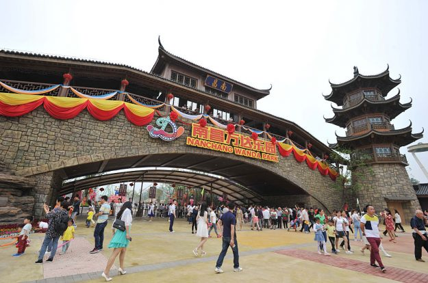 "People visit the newly open theme park ""Wanda City"" in Nanchang, east China's Jiangxi province on May 28, 2016. The Chinese conglomerate Wanda on May 28 opened its first theme park, with its billionaire boss declaring war on Disney weeks before the American entertainment giant launches a similar attraction in Shanghai. / AFP / STR / China OUT (Photo credit should read STR/AFP/Getty Images)"
