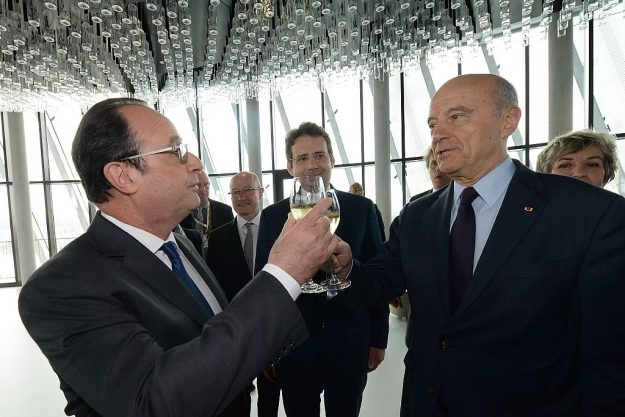 Bordeaux mayor Alain Juppe (R) and French President Francois Hollande (L) raise a toast as French junior minister for Foreign Trade, the Promotion of Tourism and French Nationals Abroad, Matthias Fekl (C) looks on, during the inauguration of the Cite du Vin (Wine Museum) on May 31, 2016 in Bordeaux. New cultural, touristic and architectural symbol of Bordeaux, the Wine Museu wishes to attract 450,000 visitors per year, is set to open on June 1 following its inauguration by Francois Hollande. / AFP / POOL / MEHDI FEDOUACH (Photo credit should read MEHDI FEDOUACH/AFP/Getty Images)