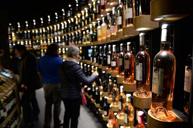 People look at bottles of wine as they visit La Cite du Vin (Wine Museum) as it opens its doors to the public in Bordeaux on June 1, 2016. La Cite du Vin opened its doors to the public on June 1. The 13 350 m2 compound offers thematics areas about the history and civilisations of wine around the world with digital and sensory exhibits. / AFP / MEHDI FEDOUACH (Photo credit should read MEHDI FEDOUACH/AFP/Getty Images)