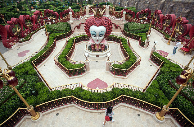 A girl walks in 'Alice in Wonderland Maze' at Shanghai Disney Resort in Shanghai on June 15, 2016. The Magic Kingdom comes to the Middle Kingdom this week when Disney opens its first theme park in mainland China, betting the growing middle class will spend big on leisure despite a slowing economy.