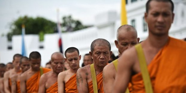 Monks queue to celebrate the kings anniversary