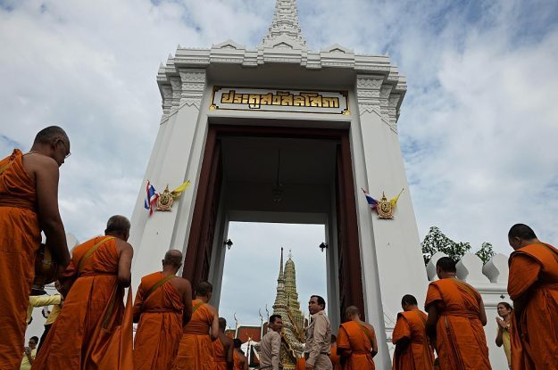 Monks enter The Grand Palace during the commemoration